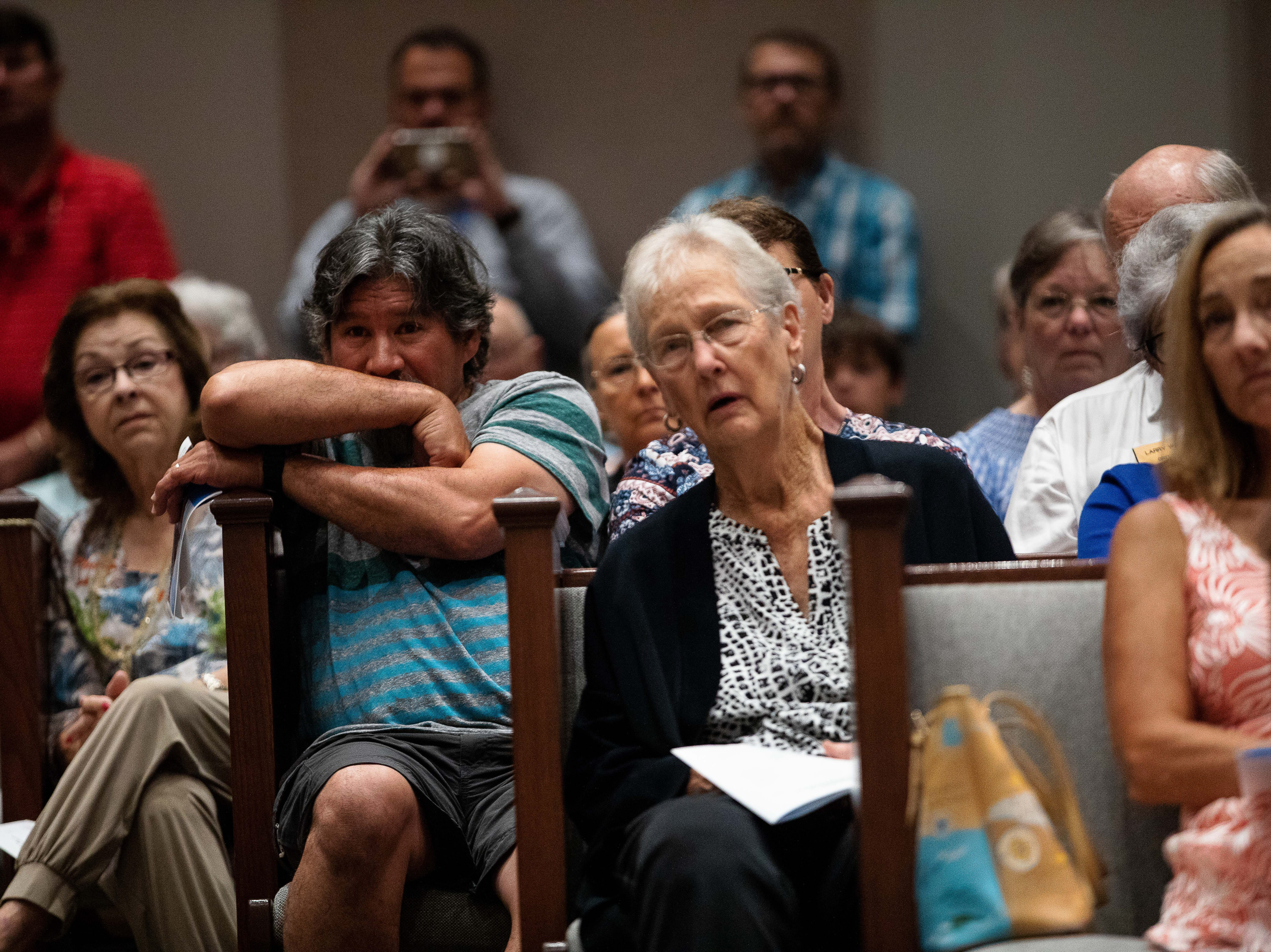 People listen to Cynthia Williams talk about her experience with Hurricane Harvey and its aftermath at the First Baptist Church of Rockport during a Hurricane Harvey anniversary service on Sunday, Aug. 26, 2018.