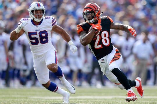 Cincinnati Bengals running back Joe Mixon (28) runs after a reception in the first quarter during the Week 3 NFL preseason game between the Cincinnati Bengals and the Buffalo Bills, Sunday, Aug. 26, 2018, at New Era Stadium in Orchard Park, New York.