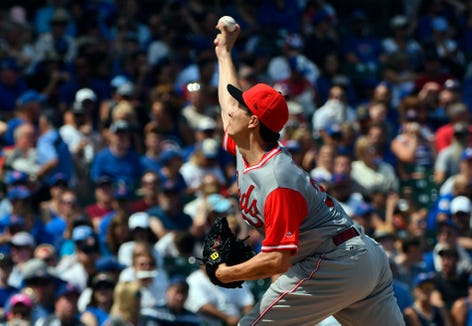 Aug 26, 2018; Chicago, IL, USA; Cincinnati Reds starting pitcher Homer Bailey (34) delivers against the Chicago Cubs in the first inning at Wrigley Field. Mandatory Credit: Matt Marton-USA TODAY Sports