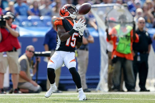 Cincinnati Bengals wide receiver John Ross (15) catches a deep pass for a touchdown in the first quarter during the Week 3 NFL preseason game between the Cincinnati Bengals and the Buffalo Bills, Sunday, Aug. 26, 2018, at New Era Stadium in Orchard Park, New York.