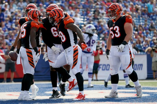 Cincinnati Bengals wide receiver John Ross (15), far left, is congratulated after scoring a touchdown in the first quarter during the Week 3 NFL preseason game between the Cincinnati Bengals and the Buffalo Bills, Sunday, Aug. 26, 2018, at New Era Stadium in Orchard Park, New York.