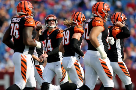 Cincinnati Bengals quarterback Andy Dalton (14), center, looks to the scoreboard after a stalled drive in the second quarter during the Week 3 NFL preseason game between the Cincinnati Bengals and the Buffalo Bills, Sunday, Aug. 26, 2018, at New Era Stadium in Orchard Park, New York.