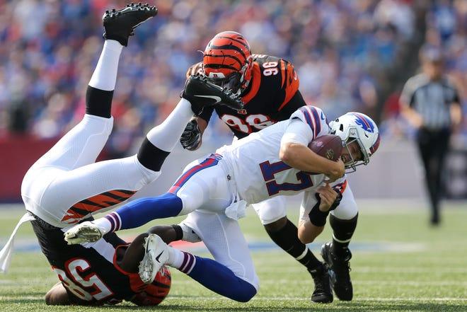 Cincinnati Bengals defensive end Carl Lawson (58) sacks Buffalo Bills quarterback Josh Allen (17) in the first quarter during the Week 3 NFL preseason game between the Cincinnati Bengals and the Buffalo Bills, Sunday, Aug. 26, 2018, at New Era Stadium in Orchard Park, New York.