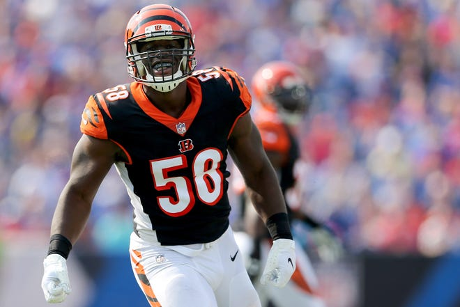 Cincinnati Bengals defensive end Carl Lawson (58) celebrates a sack of Buffalo Bills quarterback Josh Allen (17) (not pictured) in the first quarter during the Week 3 NFL preseason game between the Cincinnati Bengals and the Buffalo Bills, Sunday, Aug. 26, 2018, at New Era Stadium in Orchard Park, New York.