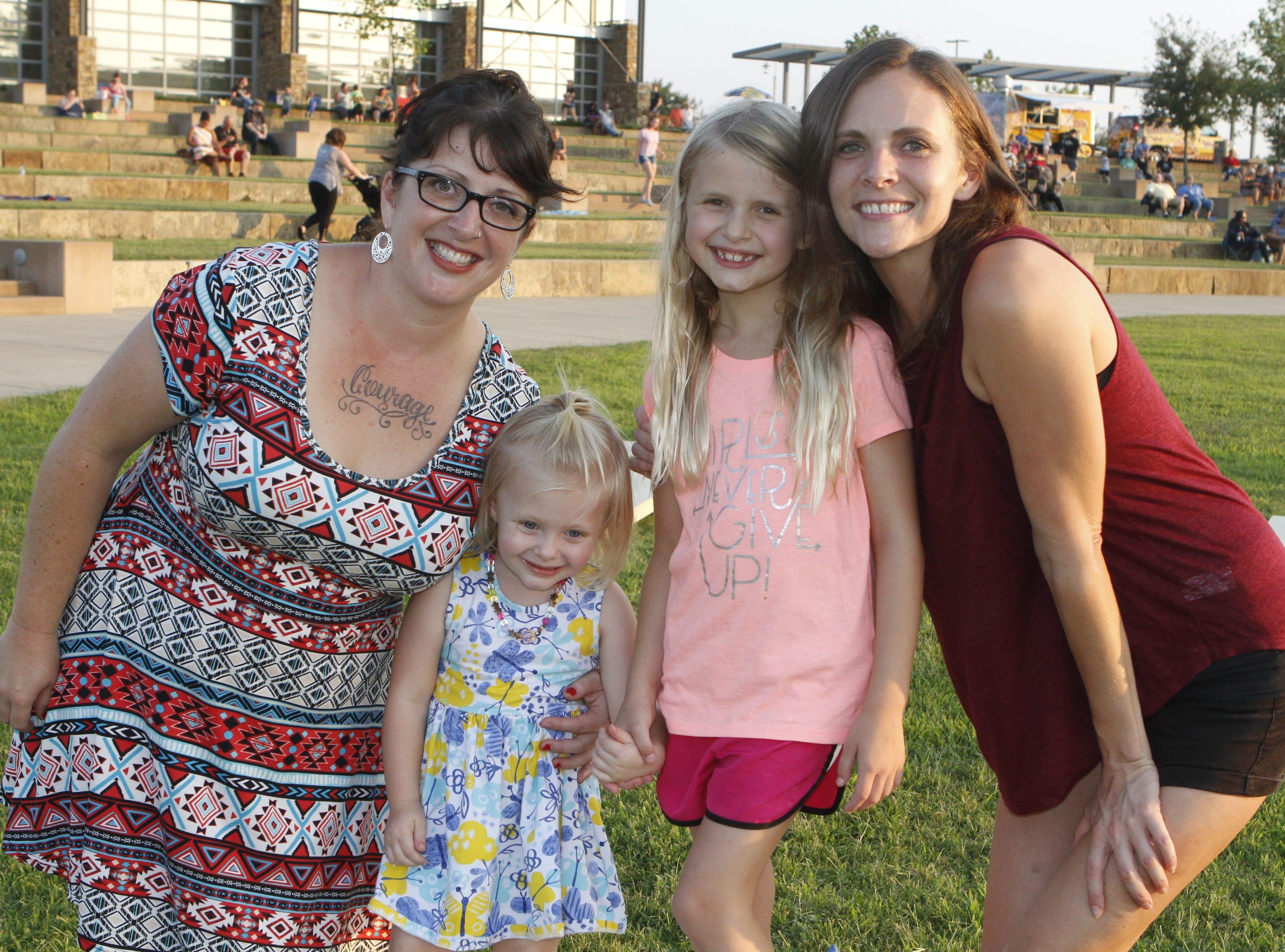 Hannah Bush, Juniper Resha, Emma Hodge, and Megan Snyder at Saturday's Road to Riverfest, a Liberty Park summer concert series event.