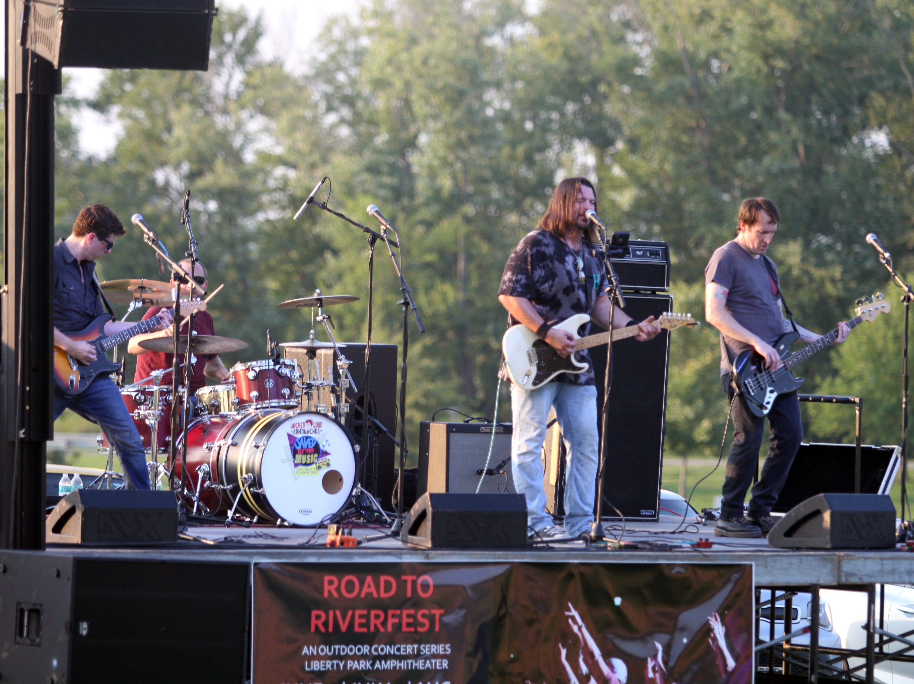 Saved By The Music: The Ultimate 90's Experience performs at Saturday's Road to Riverfest, a Liberty Park summer concert series event.