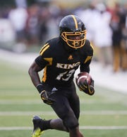 Detroit King's Rashawn Williams runs the ball against East St. Louis on Saturday, Aug. 25, 2018, at Adams Field on the Wayne State campus in Detroit.