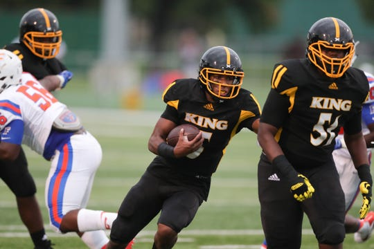 Detroit King's DeQuan Finn runs for a touchdown against East St. Louis on Saturday, Aug. 25, 2018, at Adams Field on the Wayne State campus in Detroit.
