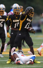 Detroit King's Rashawn Williams makes a catch against East St. Louis' Elijah Felton on Saturday, Aug. 25, 2018, at Adams Field on the Wayne State campus in Detroit.