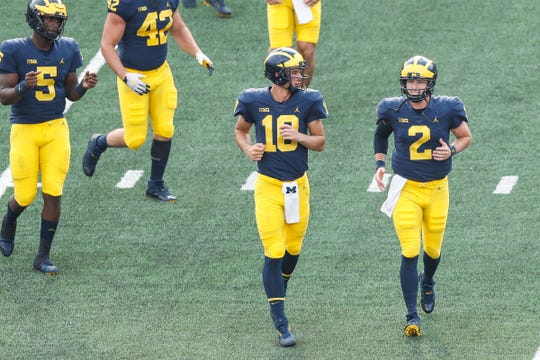 Michigan quarterbacks Dylan McCaffrey (10) and Shea Patterson (2) during an open practice at the Michigan Stadium in Ann Arbor, Sunday, Aug. 26, 2018.