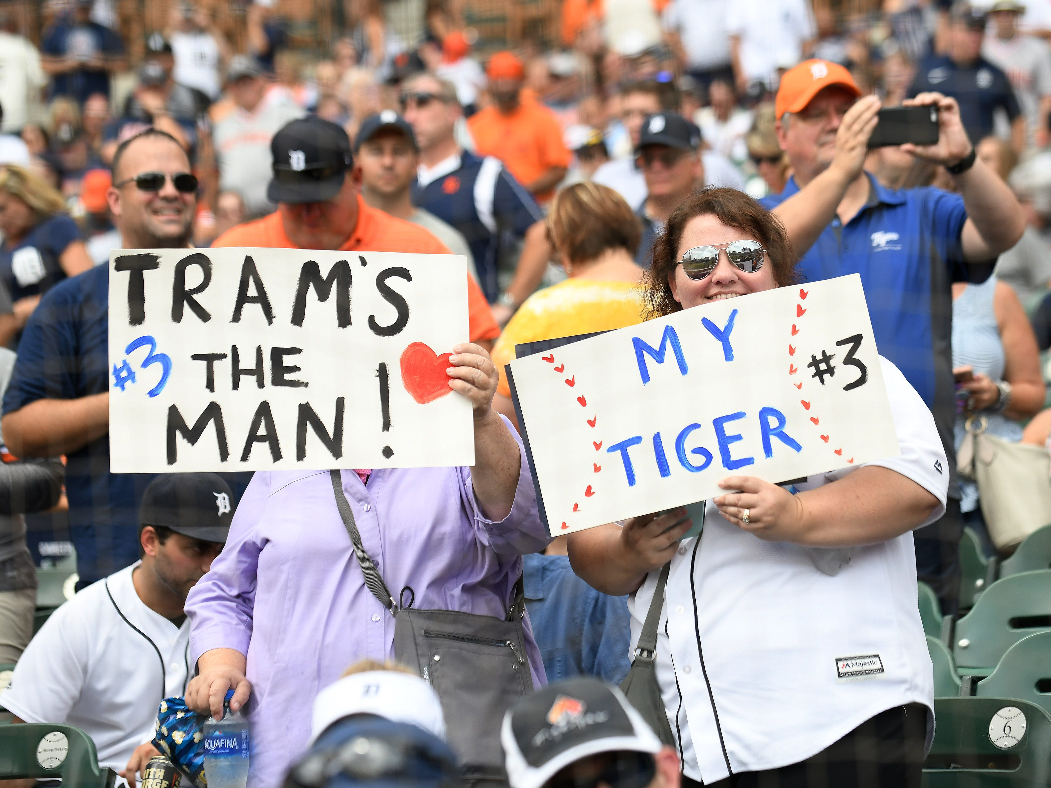 Fans with Trammell signs after a special pregame ceremony.