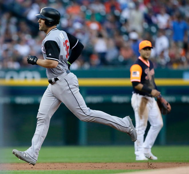 Kevan Smith (36) of the Chicago White Sox rounds the bases after hitting a home run against the Detroit Tigers during the second inning.