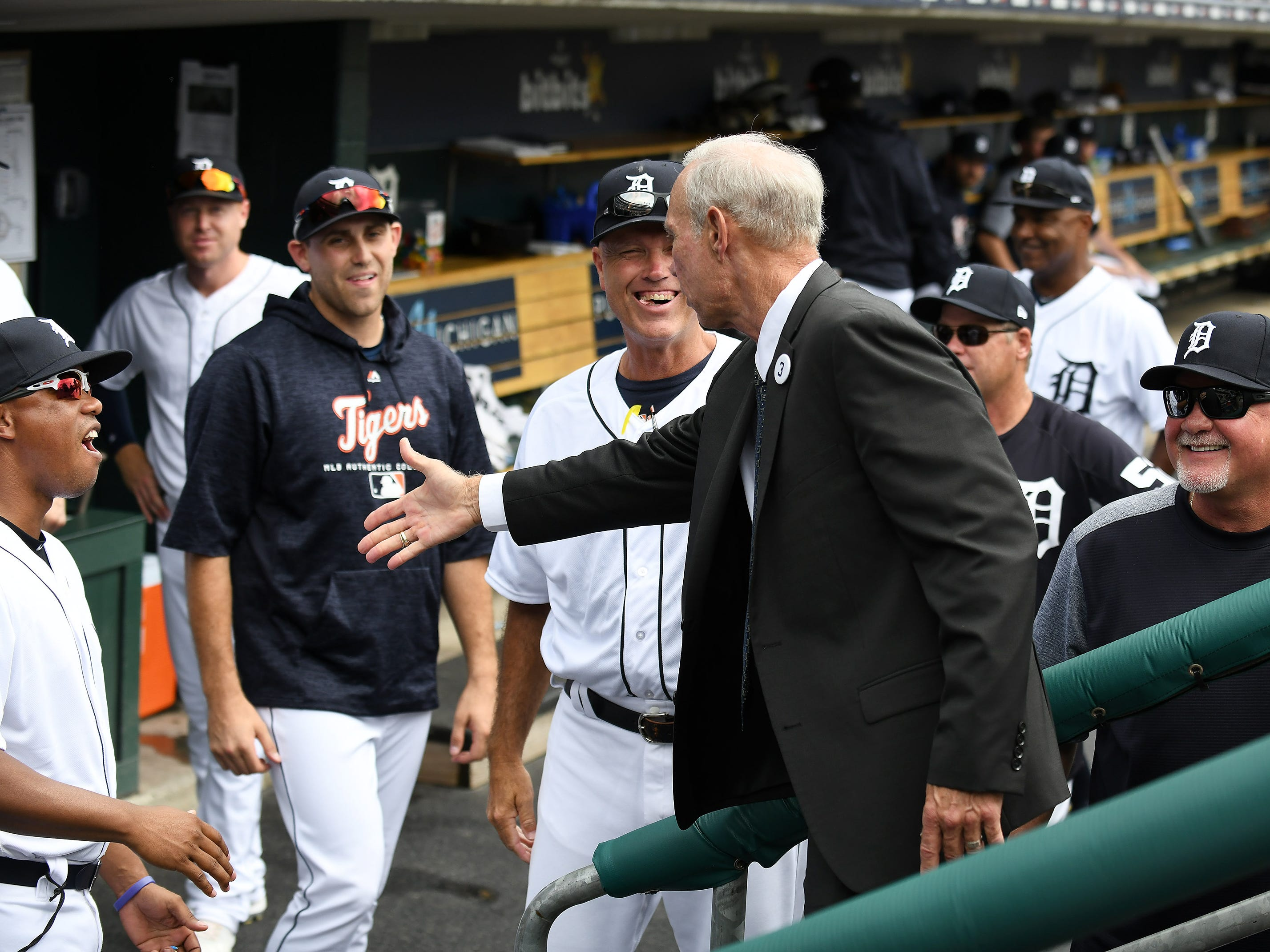 Alan Trammell chats with guys in the Tigers dugout before he throws out the ceremonial first pitch.