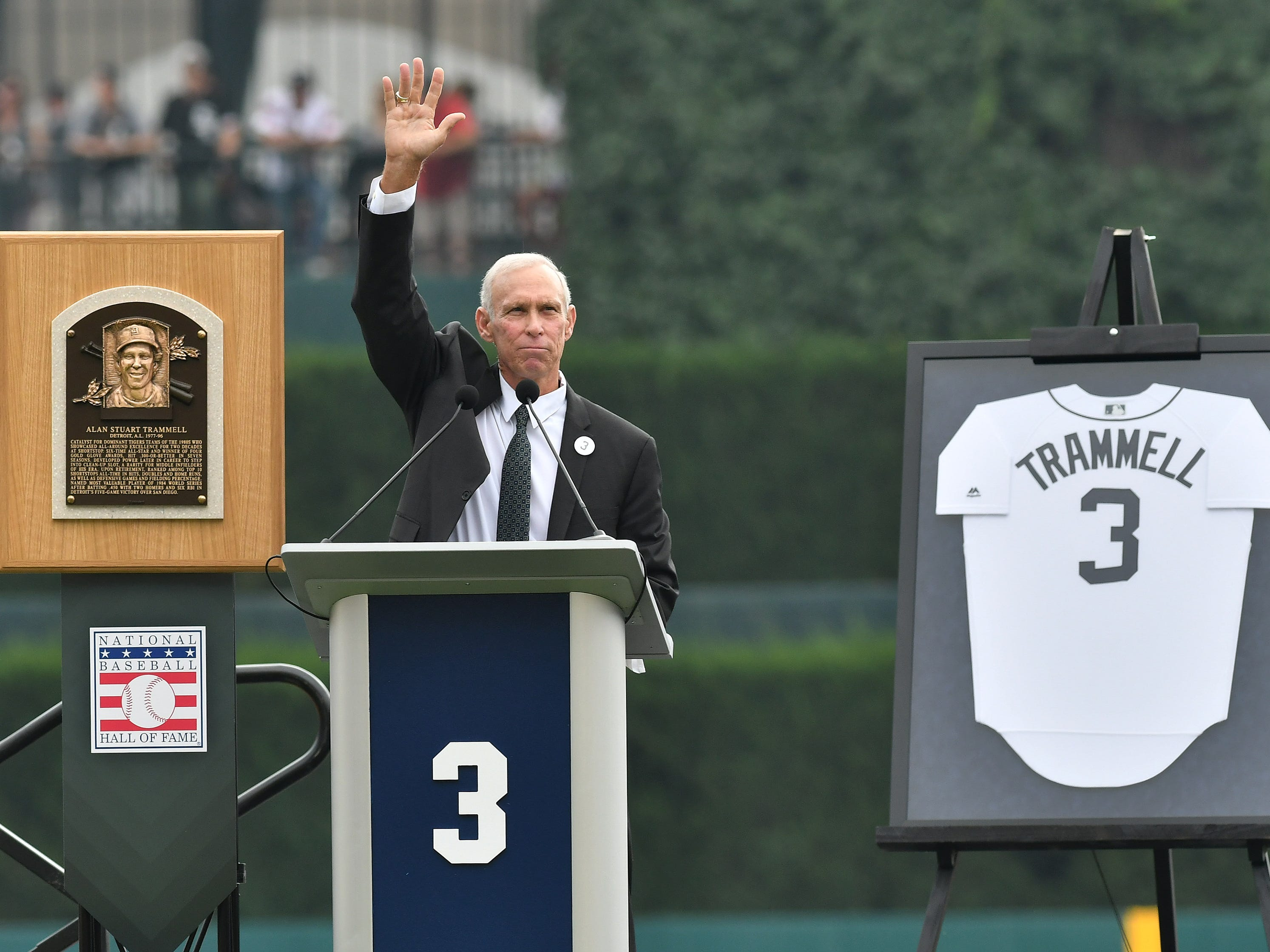 Between his Hall of Fame plaque and his No 3 jersey, Alan Trammell waves to the crowd while he speaks during a special pregame ceremony to retire his number.