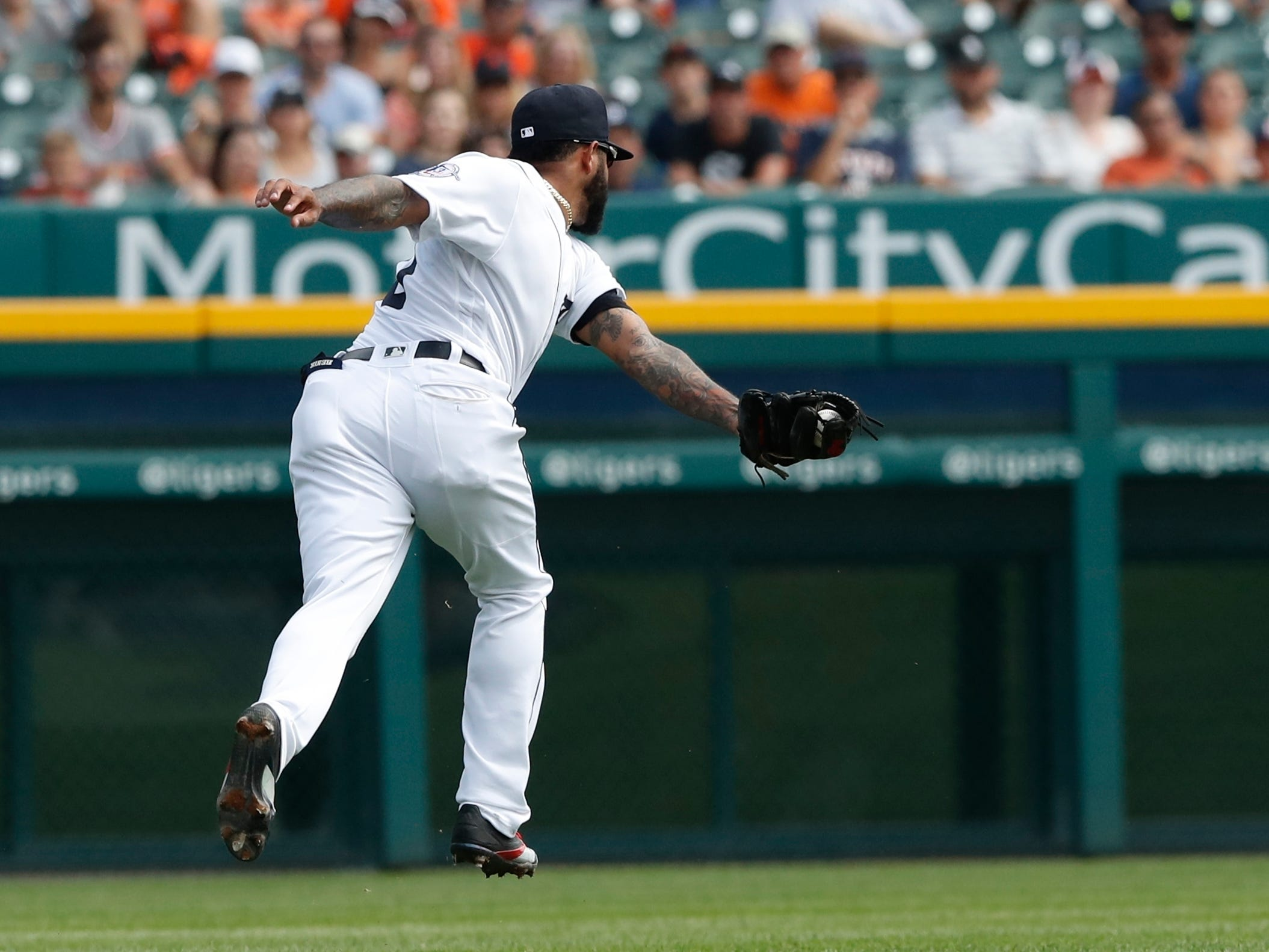 Detroit Tigers shortstop Ronny Rodriguez chases and catches a pop-up for an out hit by Chicago White Sox's Nicky Delmonico during the fourth inning.