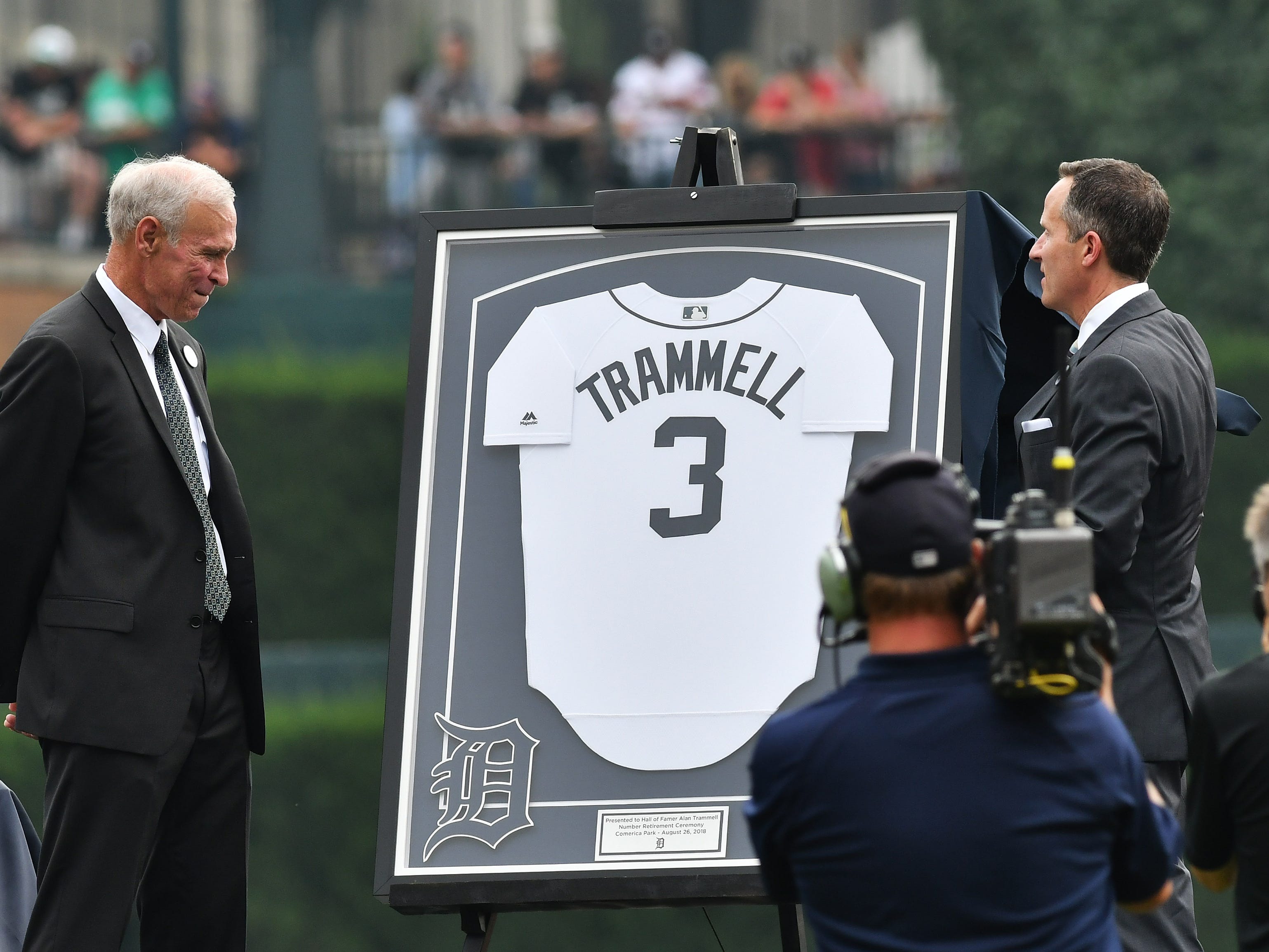 President and CEO of Ilitch Holdings, Inc. Chris Ilitch, right, presents Alan Trammell with a framed jersey and inscription during the ceremony.