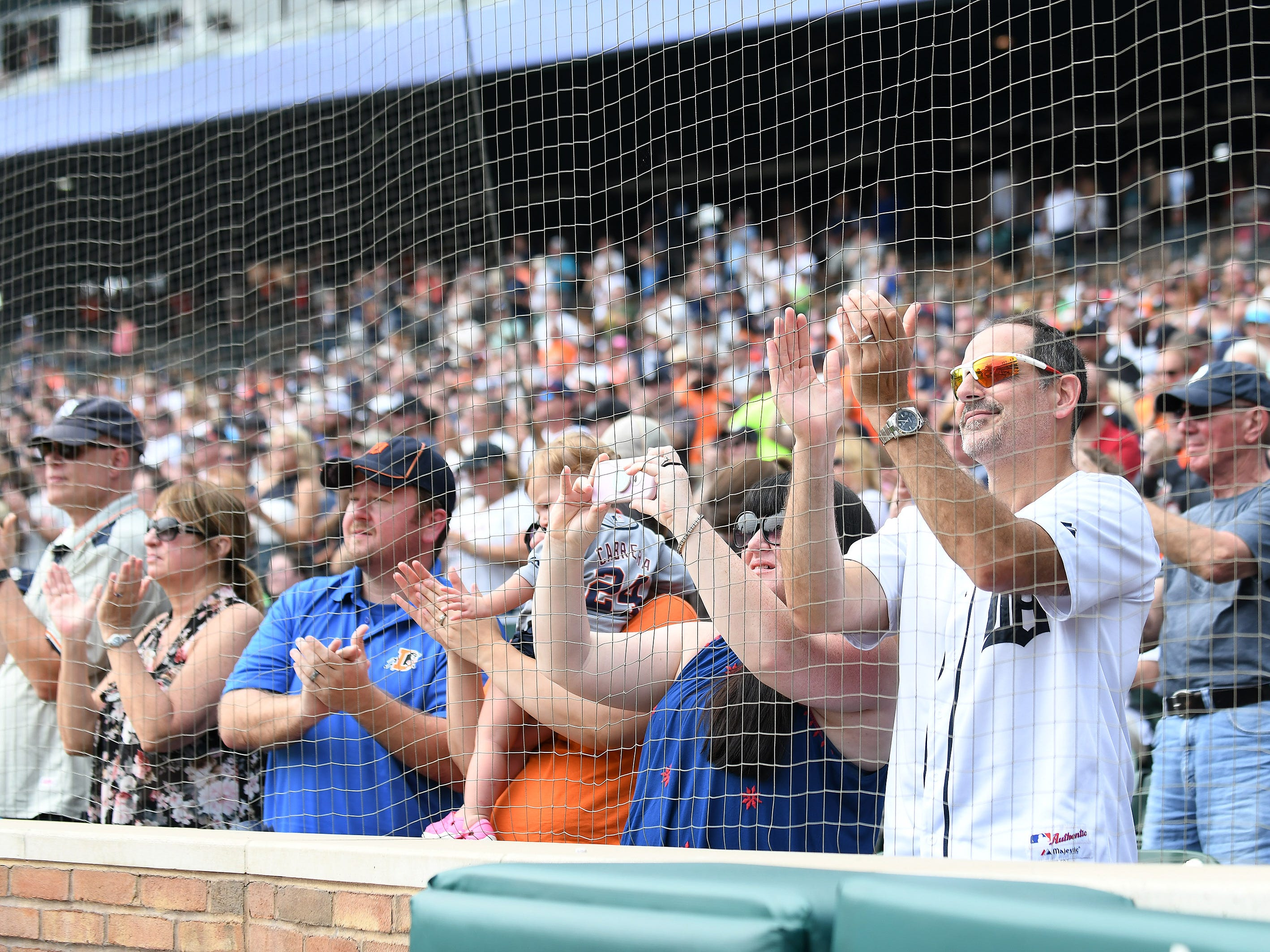 Fans cheer for Alan Trammell before he speaks during the ceremony.