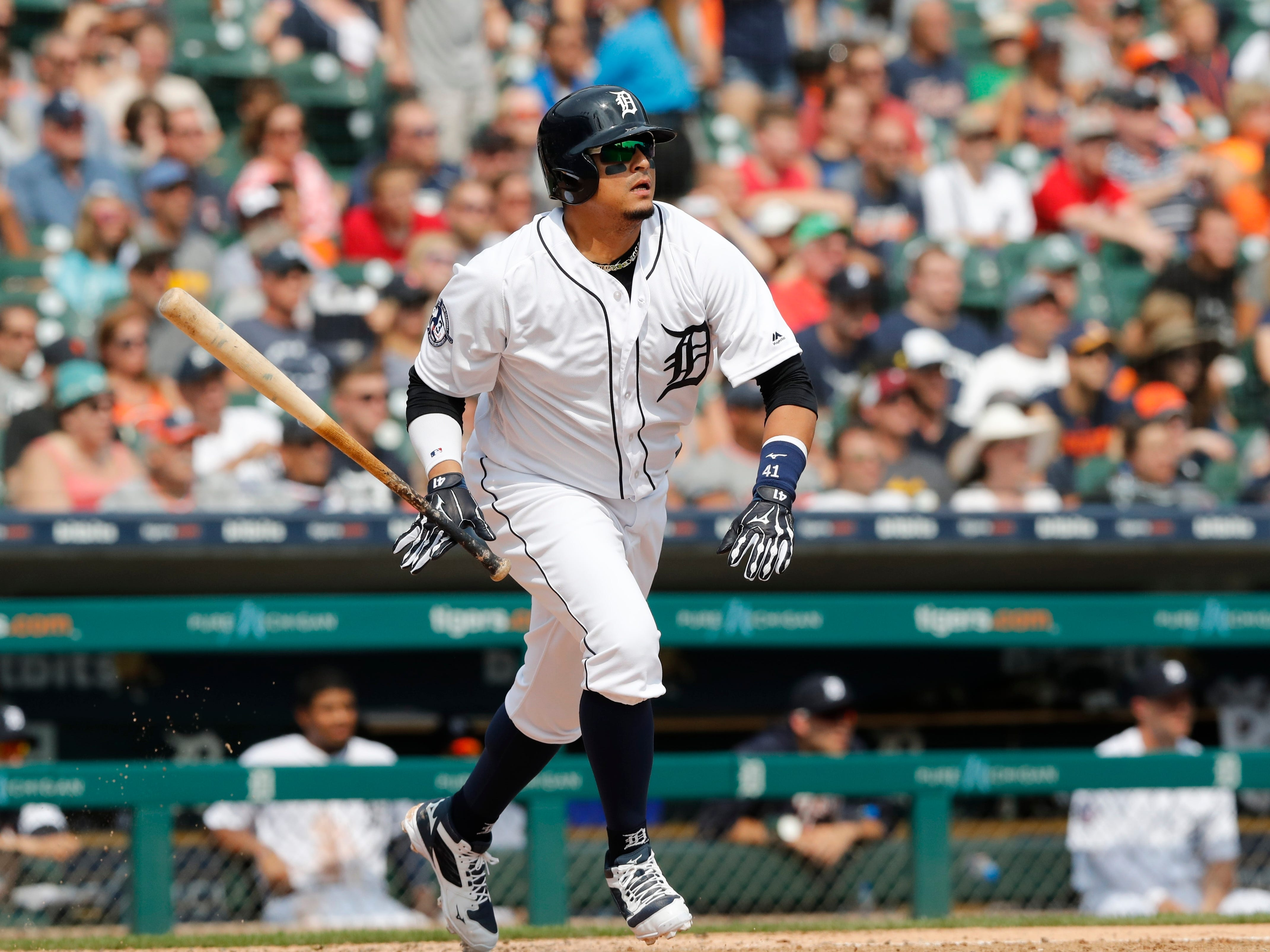 Detroit Tigers designated hitter Victor Martinez watches his RBI-double to deep right during the sixth inning.