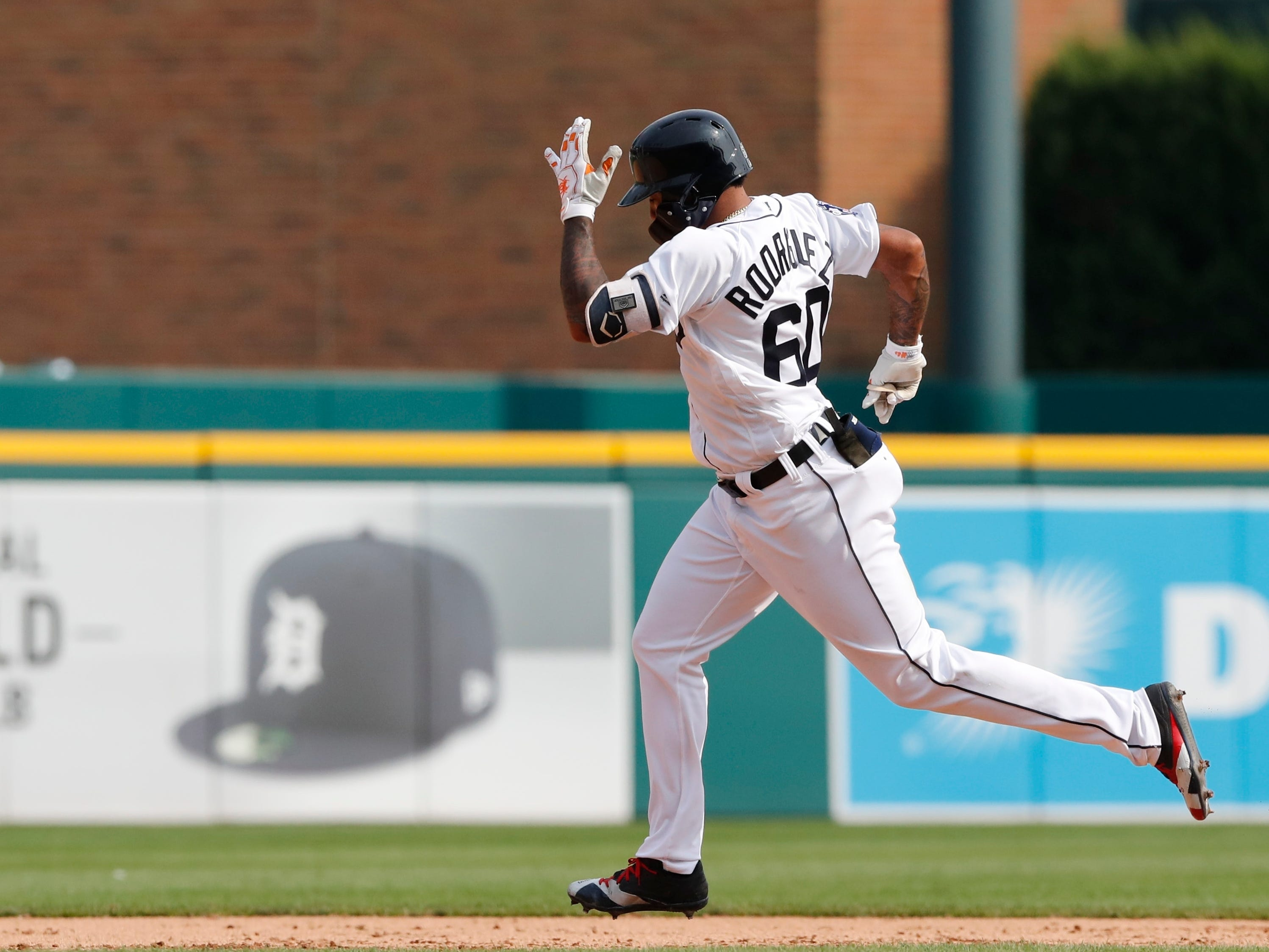 Detroit Tigers' Ronny Rodriguez rounds the bases after his solo home run during the ninth inning.