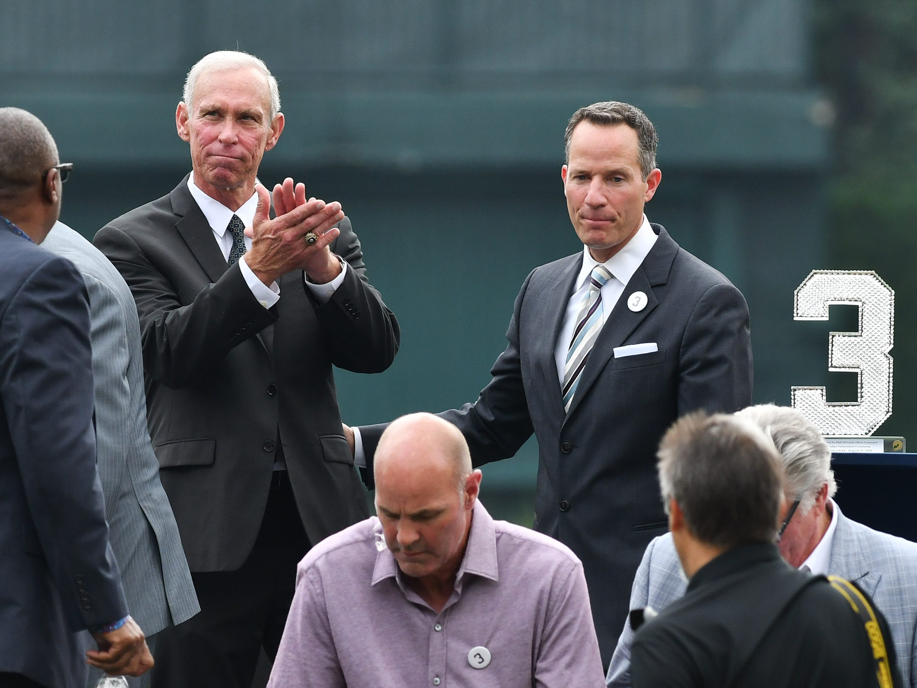 Alan Trammell applauds to fans just after the special pregame ceremony next to Chris Ilitch, president and CEO of Ilitch Holdings, Inc.
