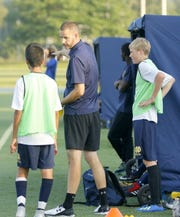 Notre Dame boys soccer coach Adam Robinson talks to one of his players Aug. 24 during a scrimmage against Horseheads at Brewer Memorial Stadium.