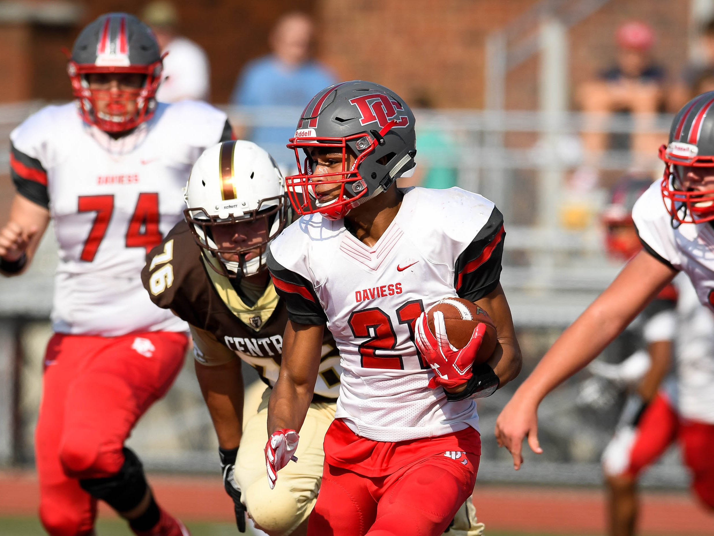 Daviess County's Jax Simpson (21) looks for running room as the Daviess County Panthers play the Evansville Central Bears at the Border Bowl played at Enlow Field in Evansville Saturday, August 25, 2018.