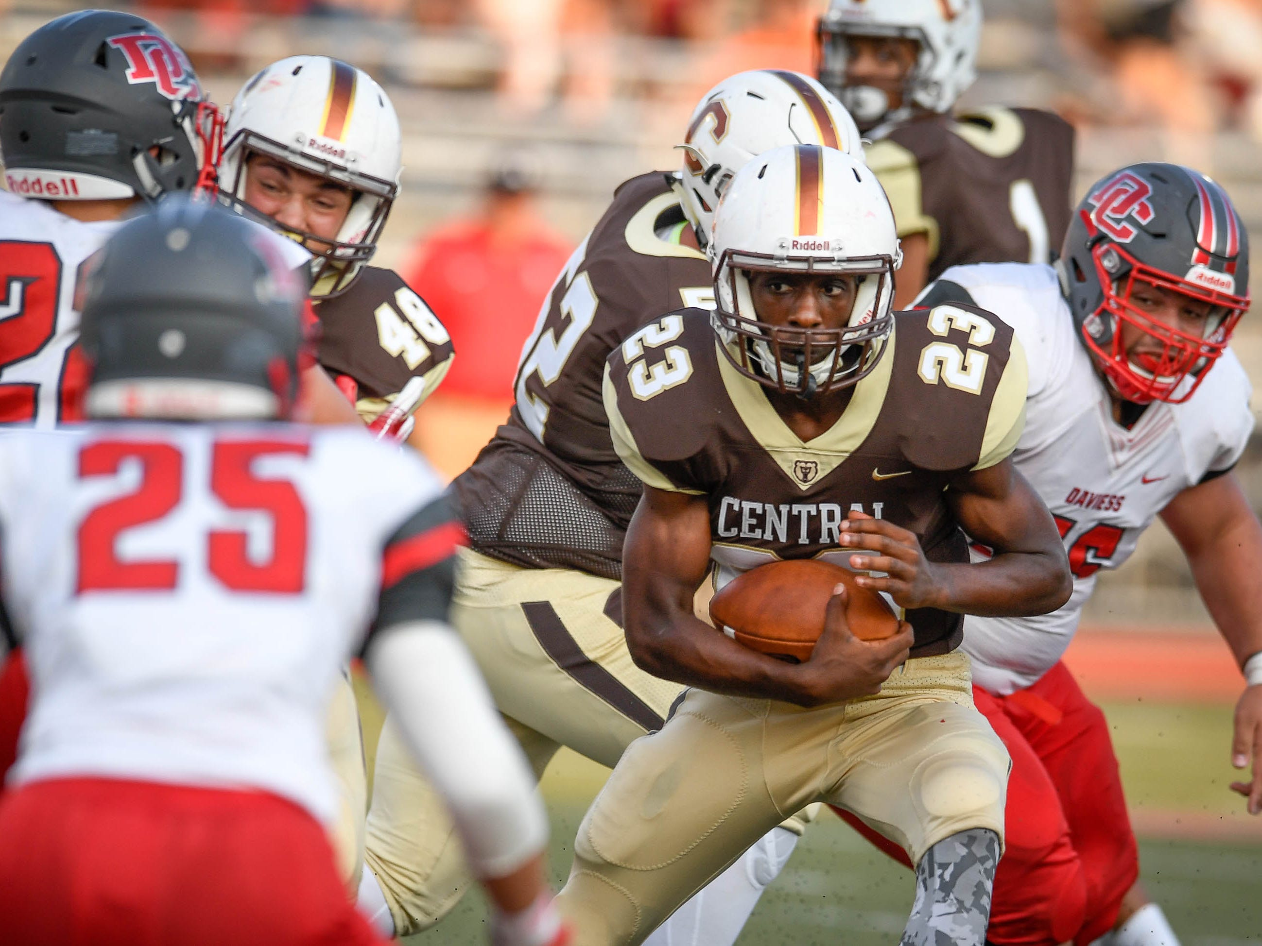 Central's Abayohmi Thompson (23) looks for yards late in the fourth quarter as the Daviess County Panthers play the Evansville Central Bears at the Border Bowl played at Enlow Field in Evansville Saturday, August 25, 2018.