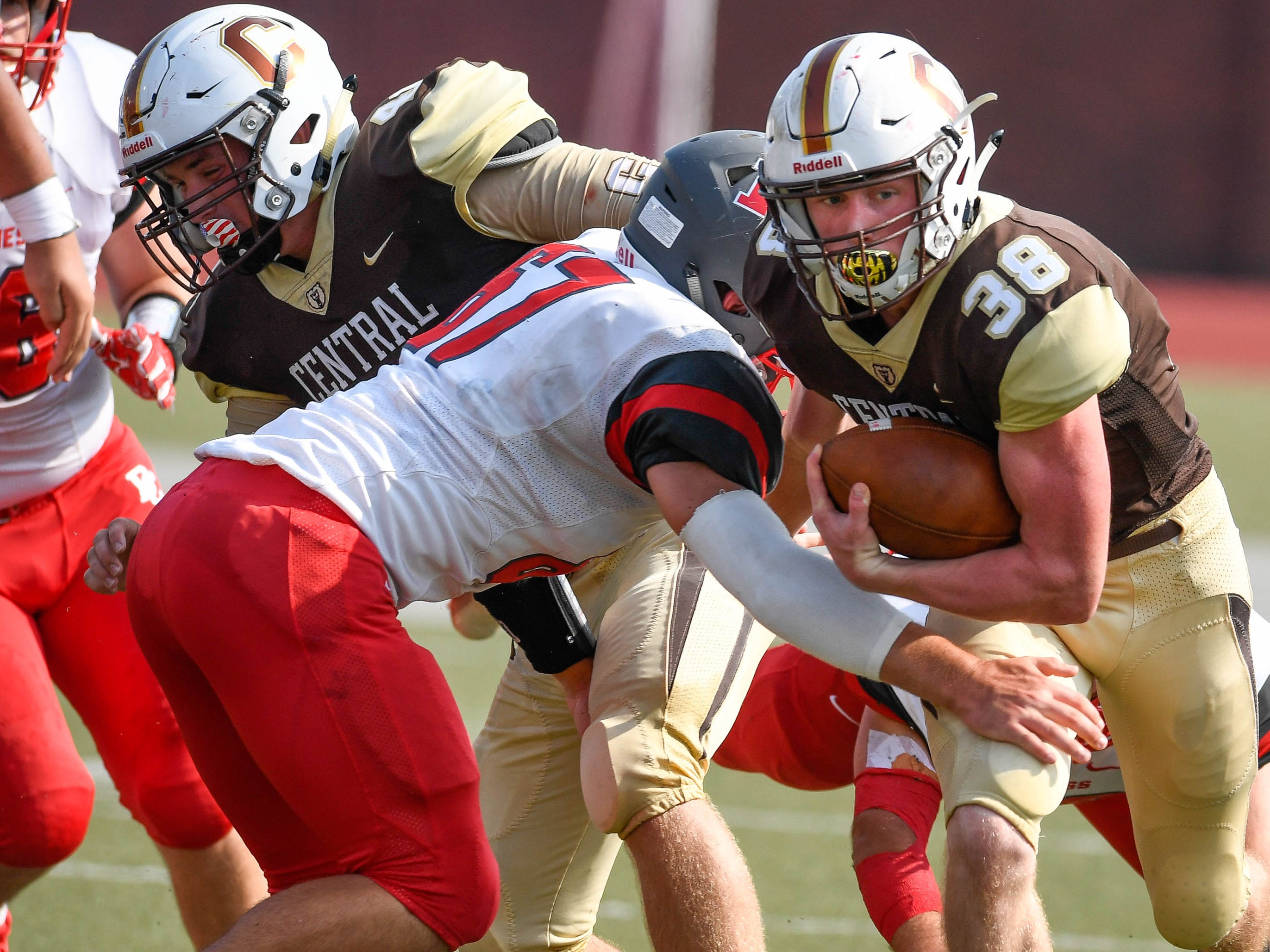 Central's Brennan Schutte (38) pushes past Daviess County's Cameron Duvall (67) as the Daviess County Panthers play the Evansville Central Bears at the Border Bowl played at Enlow Field in Evansville Saturday, August 25, 2018.