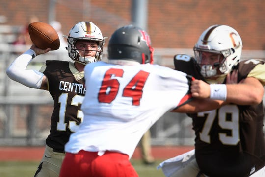 Central's Avery Zoss (79) pass blocks for quarterback Brennon Harper (13) against Daviess County at Enlow field in the Border Bowl.