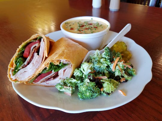 The tomato basil turkey wrap is one of the most popular lunch items at the Sidewalk Cafe. We enjoyed it with a side of broccoli salad and potato soup.