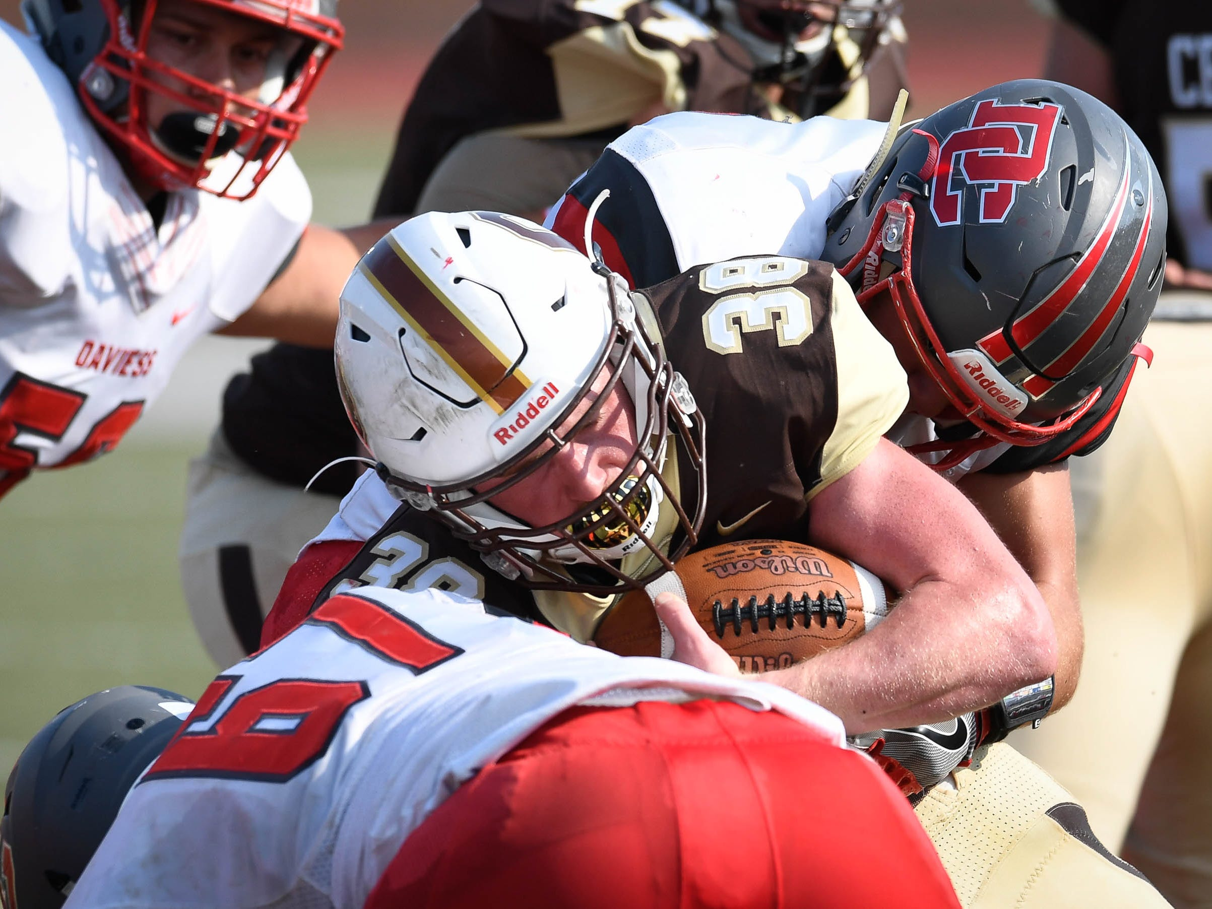 Central's Brennan Schutte (38) pushes against Daviess County's Cameron Duvall (67) as the Daviess County Panthers play the Evansville Central Bears at the Border Bowl played at Enlow Field in Evansville Saturday, August 25, 2018.