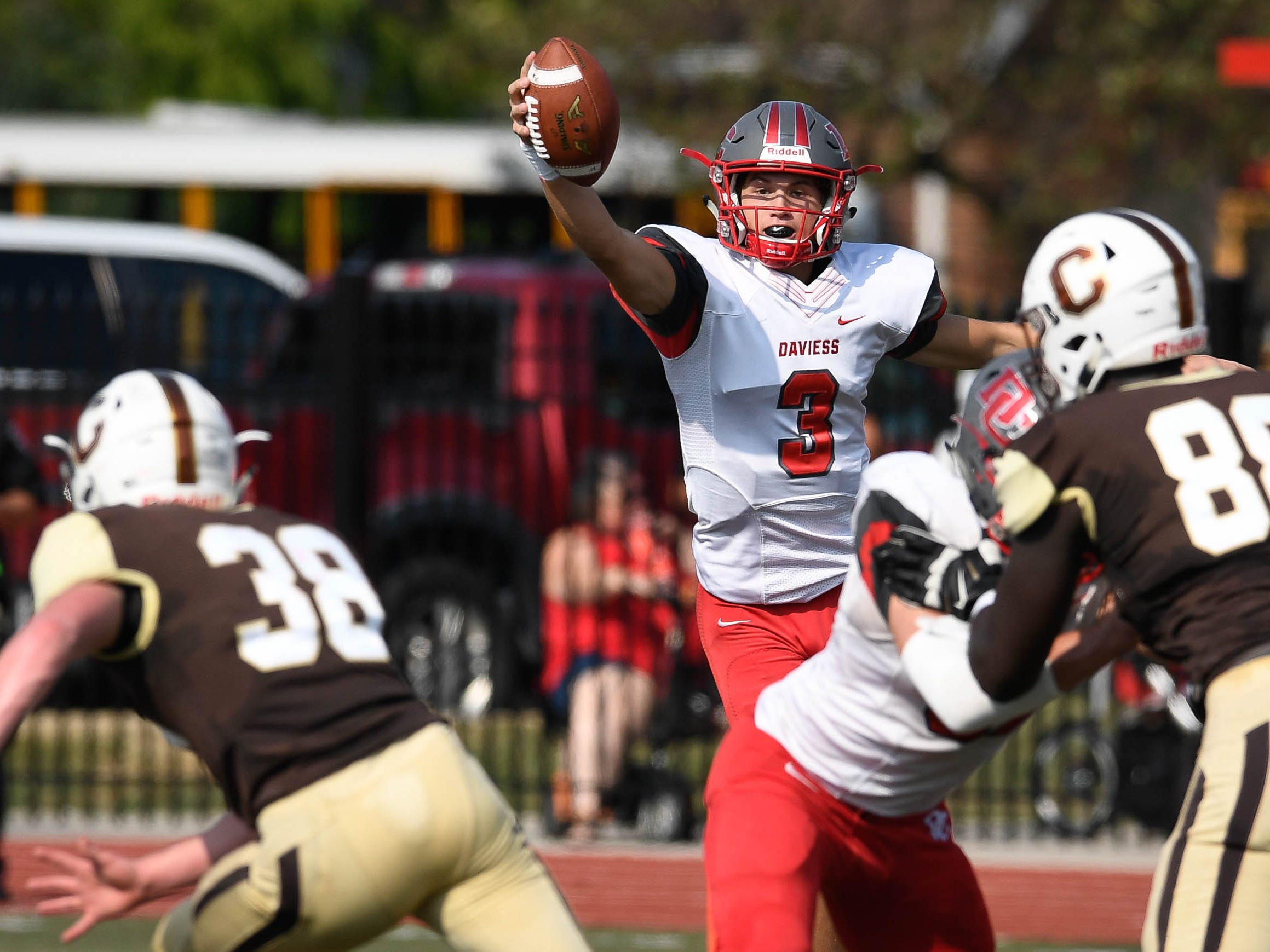 Daviess County quarterback Joseph Cambron (3) pulls down a high snap as the Daviess County Panthers play the Evansville Central Bears at the Border Bowl played at Enlow Field in Evansville Saturday, August 25, 2018.