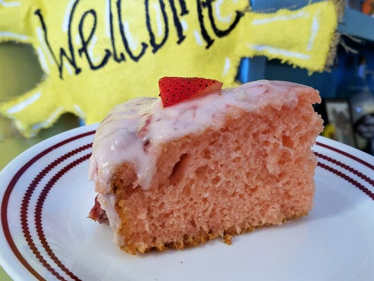 The fresh strawberry cake at the Sidewalk Cafe is Robin Cook's creation, topped with a homemade strawberry cream cheese buttercream