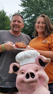 John Goodall and Mistie Cook co-own John's Smokin' BBQ in Oakland City. Look for the red building right on the highway with the welcoming pig.