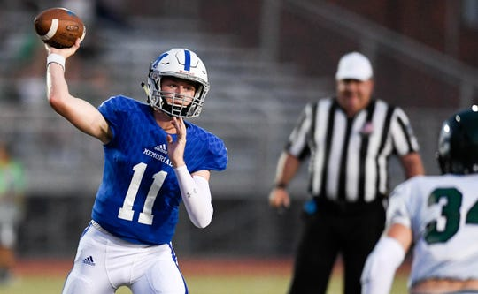 Memorial qiarterback Michael Lindauer (11) draws back to pass as the Evansville Memorial Tigers play the Owensboro Catholic Aces at the Border Bowl played at Enlow Field in Evansville Saturday, August 25, 2018.