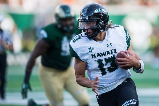 University of Hawaii sophomore quarterback Cole McDonald (13) rushes during a game against Colorado State University on Saturday, Aug. 25, 2018, at Canvas Stadium in Fort Collins, Colo.