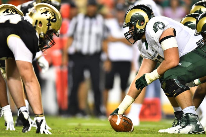 Center Jake Bennett and the CSU football team line up across from the University of Colorado Buffaloes in last year's Rocky Mountain Showdown football game in Denver. The in-state rivals meet again Friday night at Broncos Stadium at Mile High in Denver.