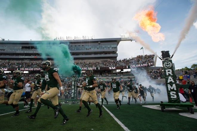 The Colorado State University football team enters the field before a game against the University of Hawaii Rainbow Warriors on Saturday, Aug. 25, 2018, at Canvas Stadium in Fort Collins, Colo.