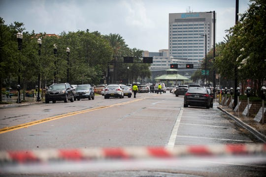 Police barricade a street near Jacksonville Landing in Jacksonville, Fla., Sunday, Aug. 26, 2018. Florida authorities are reporting multiple fatalities after a mass shooting at the riverfront mall in Jacksonville that was hosting a video game tournament.