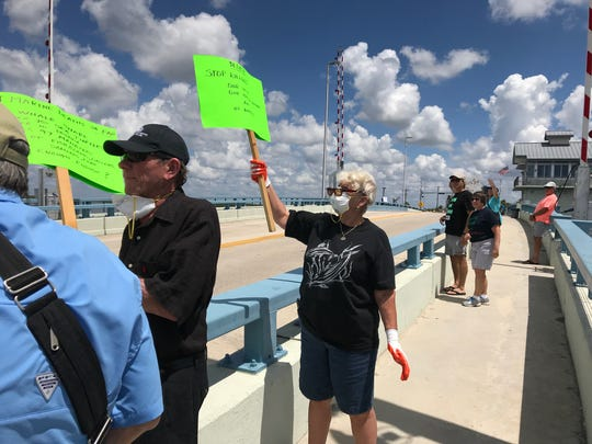 About 150 people  protested Southwest Florida water quality issues Sunday on the Matlacha Bridge.