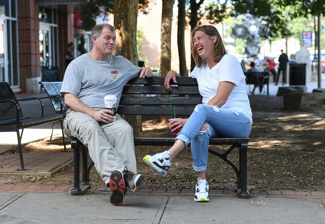 Jennifer Seymour, who is a recovering from a heroine addiction, spends time with her recovery coach Hubert Yarborough Friday in downtown Greenville. Yarborough is the coordinator of a new recovery coach program for Faces and Voices of Recovery.