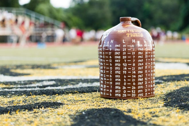 The Little Brown Jug sits on the 50-yard line before the game.