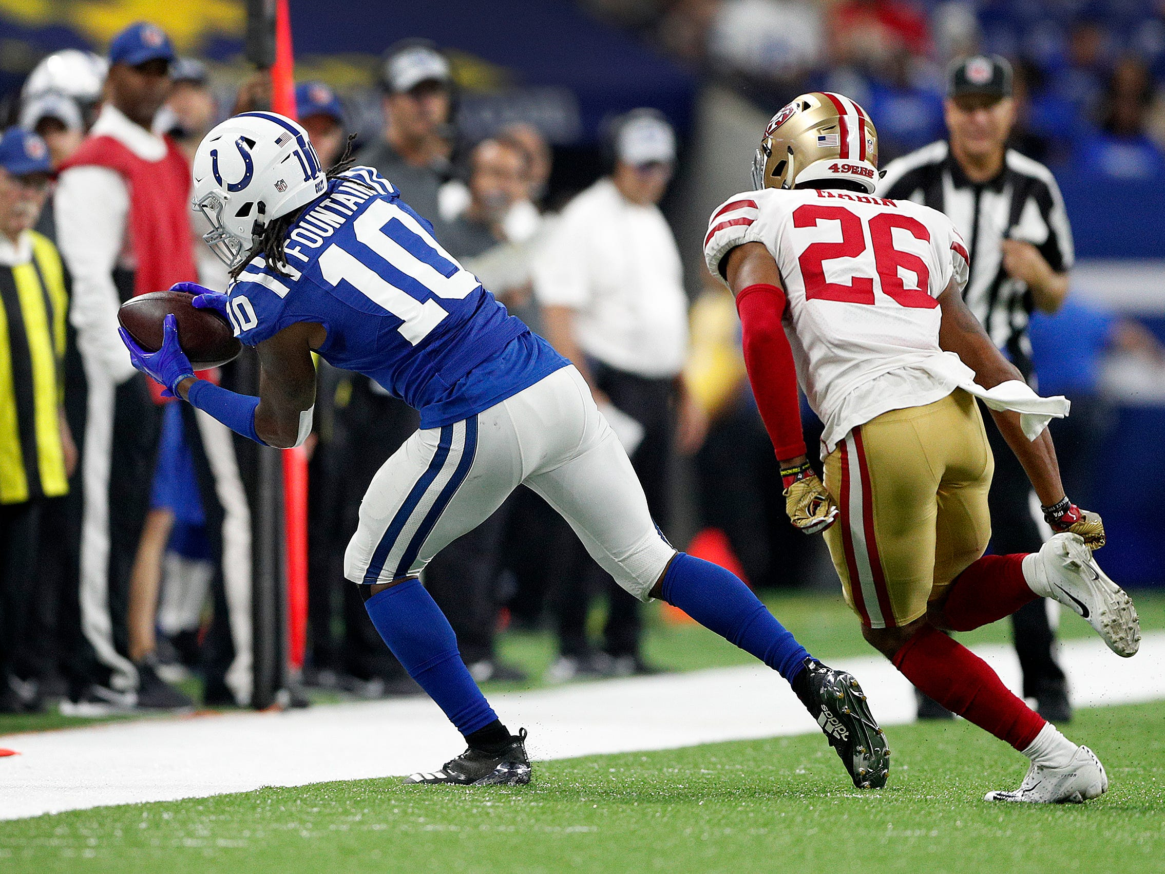 Indianapolis Colts wide receiver Daurice Fountain (10) makes a catch in front of San Francisco 49ers cornerback Greg Mabin (26) in the second half of their preseason football game at Lucas Oil Stadium Saturday, August 25, 2018. The Colts defeated the 49ers 23-17.