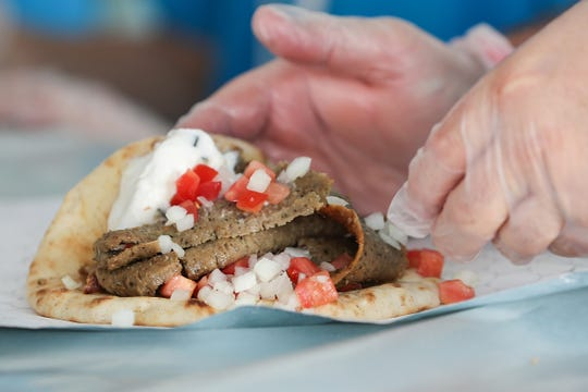 Authentic Greek gyros are prepared and served during the annual Greek Fest at Holy Trinity Greek Orthodox Church in Carmel, Ind., Sunday, Aug. 26, 2018.