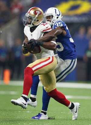 San Francisco 49ers wide receiver Pierre Garcon (15) catches a pass in front of Indianapolis Colts defensive back Pierre Desir (35) in the first half of their preseason football game at Lucas Oil Stadium Saturday, August 25, 2018.