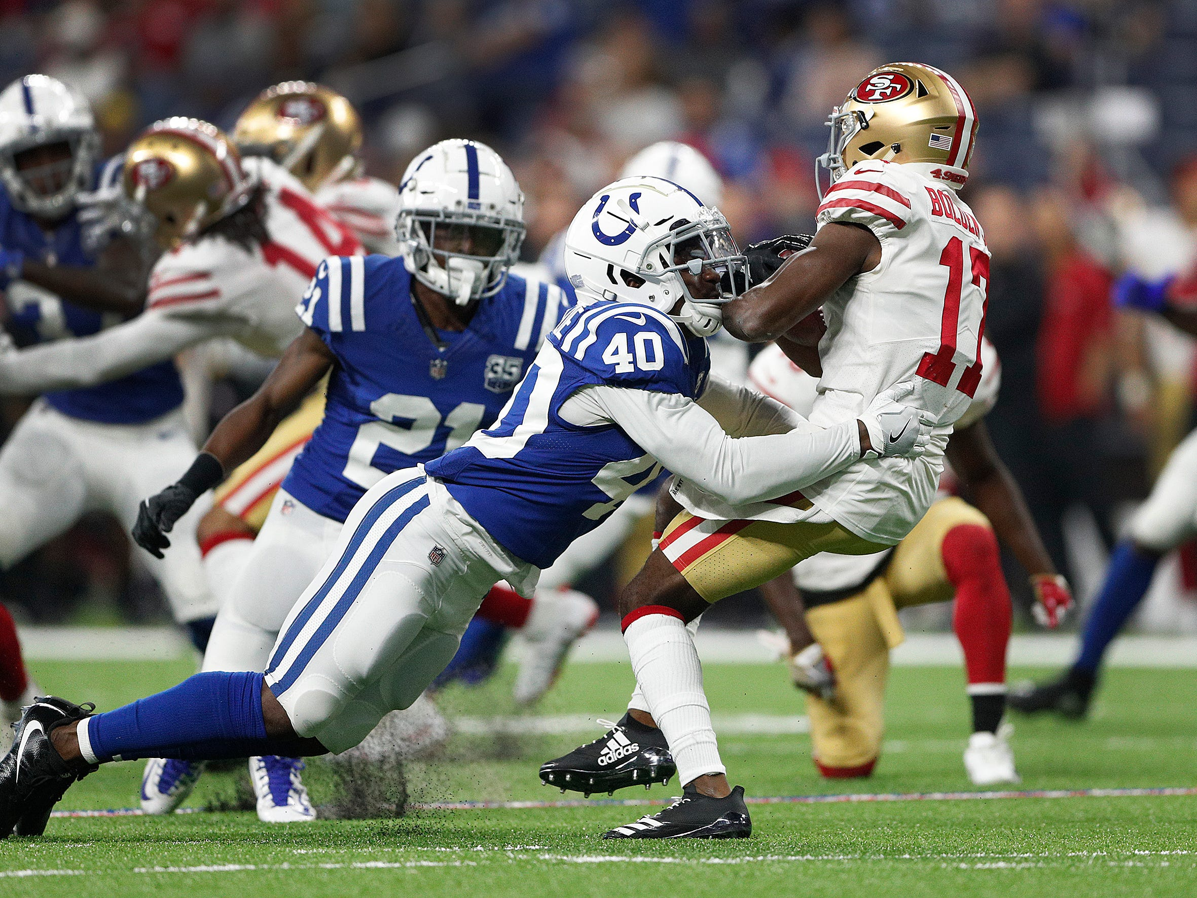 Indianapolis Colts Braden Oliver (40) hits San Francisco 49ers Victor Bolden (17) on a kickoff return in the second half of their preseason football game at Lucas Oil Stadium Saturday, August 25, 2018. The Colts defeated the 49ers 23-17.