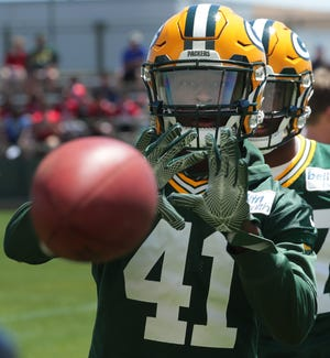 Jun 13, 2018;  Green Bay Packers cornerback Lenzy Pipkins (41) catches a ball during the final day of the Packers three day minicamp.