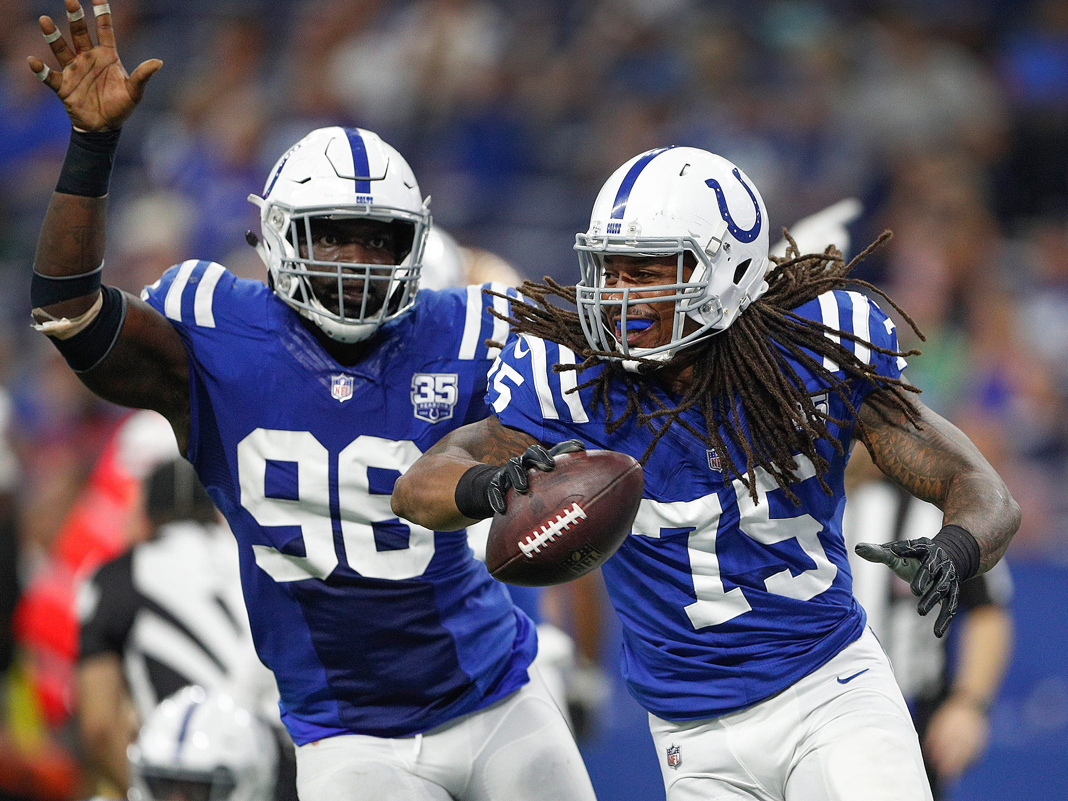 Indianapolis Colts defensive tackle Ryan Delaire (75) celebrates his fumble recovery in the second half of their preseason football game at Lucas Oil Stadium Saturday, August 25, 2018. The Colts defeated the 49ers 23-17.