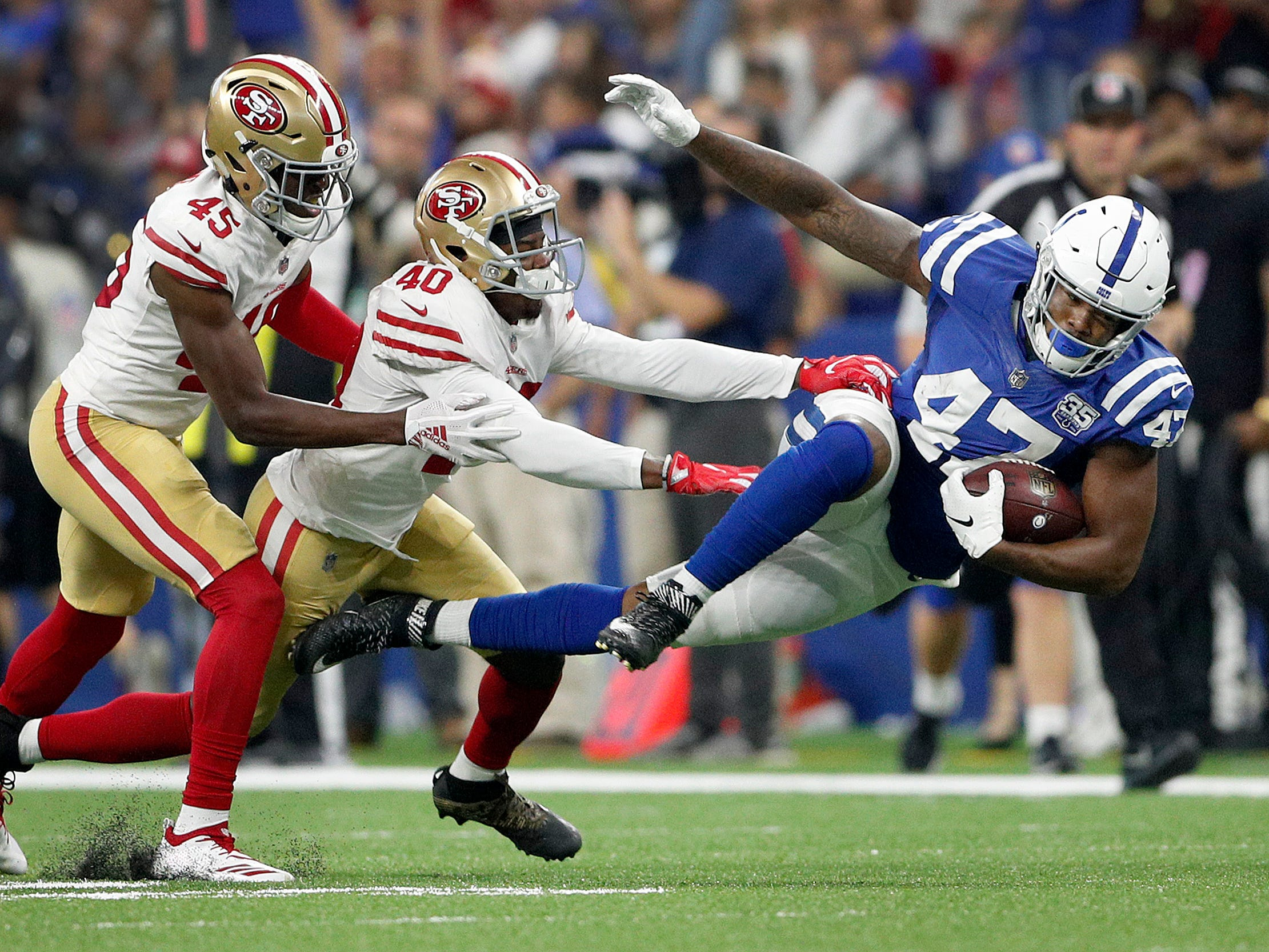 Indianapolis Colts tight end Darrell Daniels (47) is hit by San Francisco 49ers cornerback D.J. Reed (40) in the second half of their preseason football game at Lucas Oil Stadium Saturday, August 25, 2018. The Colts defeated the 49ers 23-17.