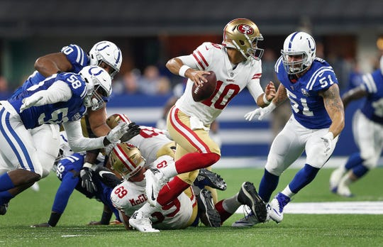 Indianapolis Colts defensive end John Simon (51) and Tarell Basham (58) chase San Francisco 49ers quarterback Jimmy Garoppolo (10) in the second half of their preseason football game at Lucas Oil Stadium Saturday, August 25, 2018. The Colts defeated the 49ers 23-17.